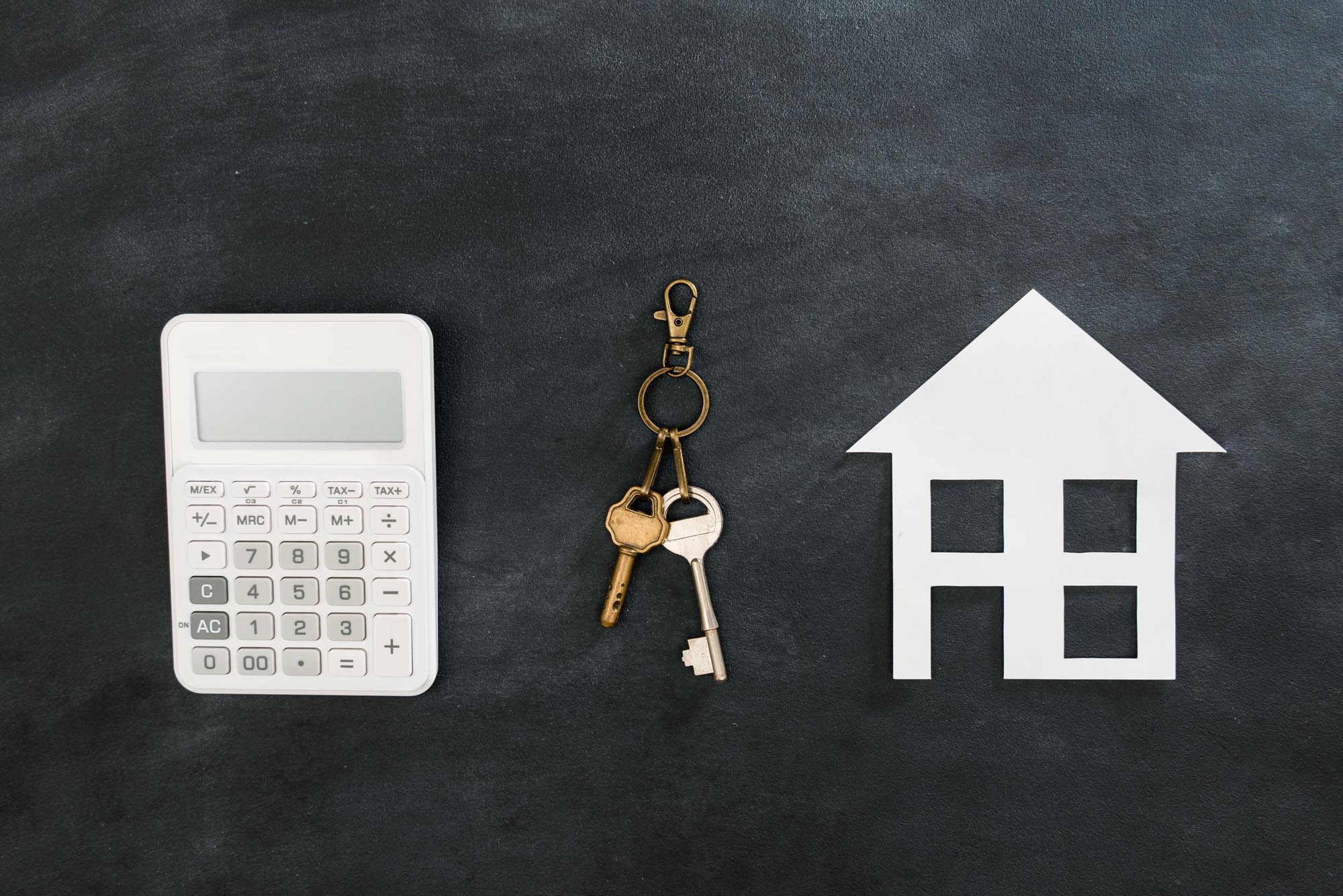 Image of a calculator and house with key